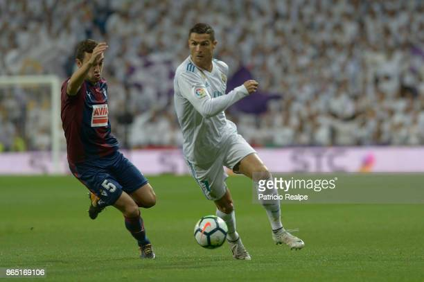 Cristiano Ronaldo of Real Madrid figths for the ball with Escalante of Eibar during a match between Real Madrid and Eibar as part of La Liga at...