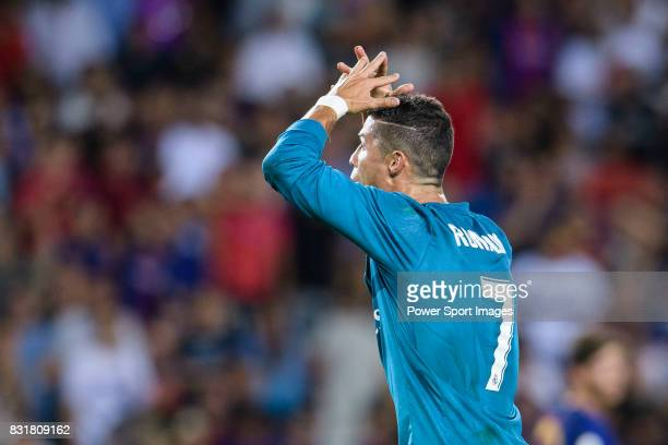 Cristiano Ronaldo of Real Madrid gestures after gets a red card during the Supercopa de Espana Final 1st Leg match between FC Barcelona and Real...