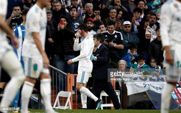 Cristiano Ronaldo of Real Madrid gets injured during the La Liga match between Real Madrid and Deportivo La Coruna at Santiago Bernabeu Stadium in...