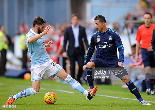 Cristiano Ronaldo of Real Madrid gets past Sergi Gonez of Celta Vigo during the La Liga match between Celta Vigo and Real Madrid at Estadio Balaidos...