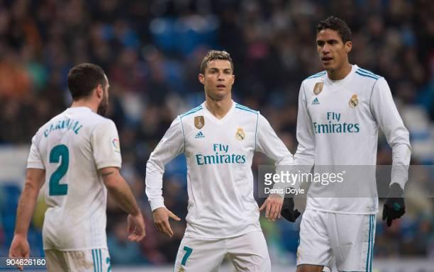 Cristiano Ronaldo of Real Madrid gets ready for a corner kick with teammates Dani Carvajal and Rafael Varane during the La Liga match between Real...