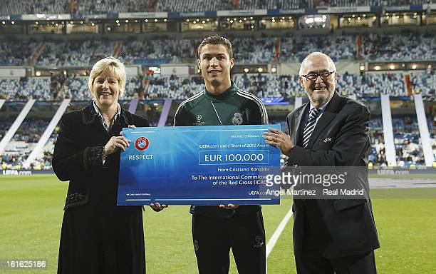 Cristiano Ronaldo of Real Madrid gives a cheque from UEFA to Caroline WelchBallentine of International Committee of the Red Cross to support the...