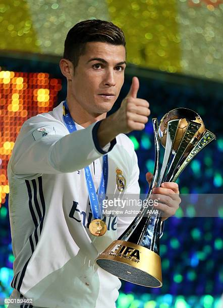 Cristiano Ronaldo of Real Madrid gives a thumbs up as he holds the trophy at the end of the FIFA Club World Cup final match between Real Madrid and...