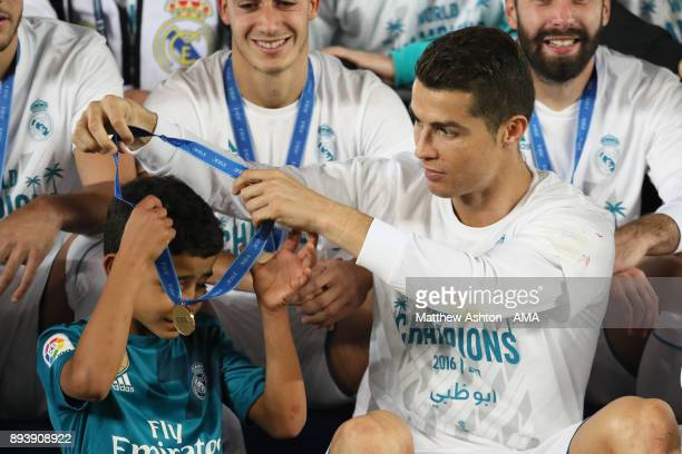 Cristiano Ronaldo of Real Madrid gives his winners medal to his his son Cristiano Ronaldo Jnr at the end of the FIFA Club World Cup UAE 2017 final...