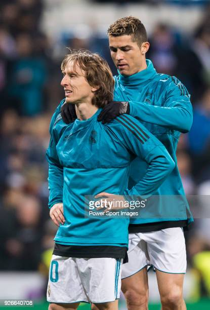 Cristiano Ronaldo of Real Madrid gives teammate Luka Modric a should massage prior to the UEFA Champions League 201718 Round of 16 match between Real...