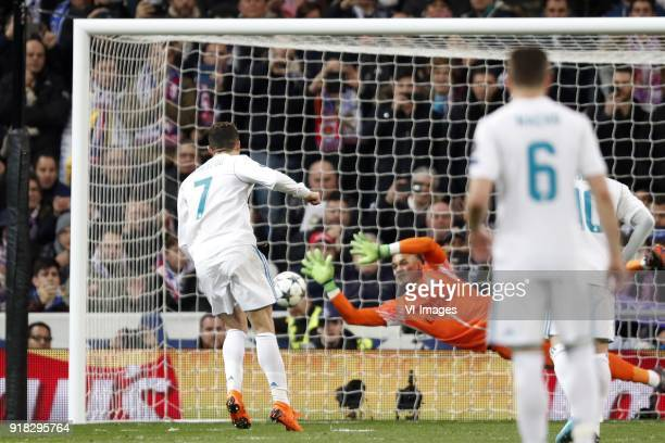 Cristiano Ronaldo of Real Madrid goalkeeper Alphonse Areola of Paris SaintGermain during the UEFA Champions League round of 16 match between Real...