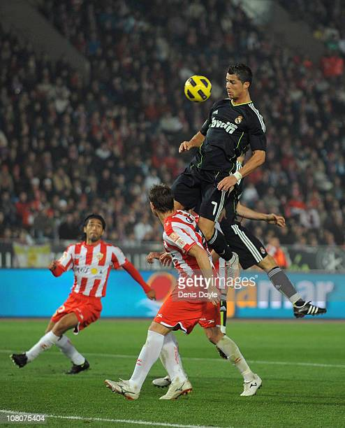 Cristiano Ronaldo of Real Madrid goes for a high ball during the La Liga match between UD Almeria and Real Madrid at Estadio del Mediterraneo on...