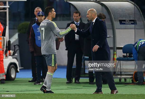 Cristiano Ronaldo of Real Madrid greets coach of Real Madrid Zinedine Zidane when he's replaced during the UEFA Champions League round of 16 first...