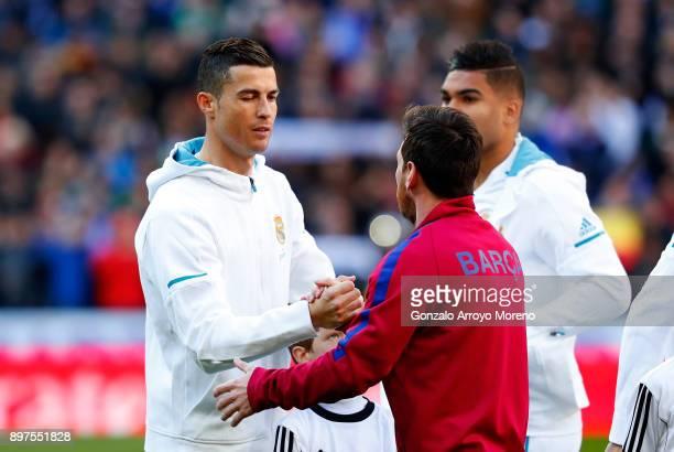 Cristiano Ronaldo of Real Madrid greets Lionel Messi of Barcelona prior to the La Liga match between Real Madrid and Barcelona at Estadio Santiago...