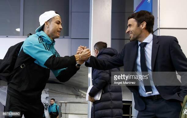 Cristiano Ronaldo of Real Madrid greets Raul Gonzalez prior to the La Liga match between Real Madrid and Barcelona at Estadio Santiago Bernabeu on...