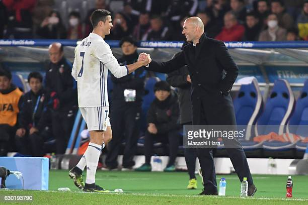 Cristiano Ronaldo of Real Madrid greets Zinedine Zidane Manager of Real Madrid after he is subtituted following an injury during the FIFA Club World...