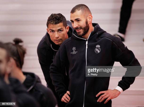 Cristiano Ronaldo of Real Madrid has a chat to Karim Benzema before the UEFA Champions League Quarter Final first leg match between FC Bayern...