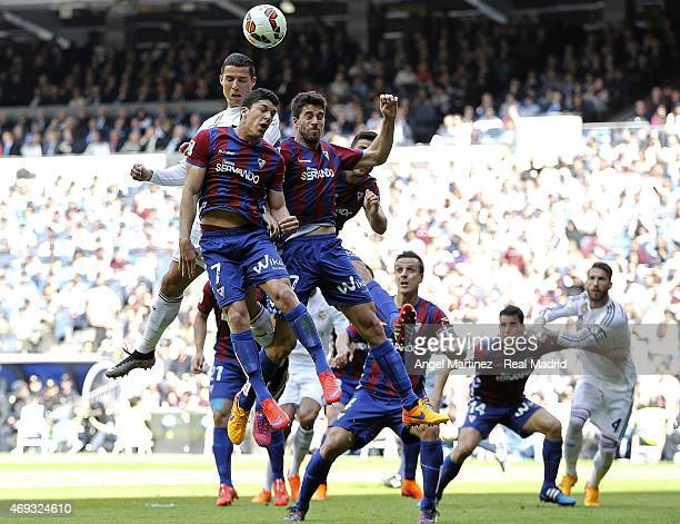 Cristiano Ronaldo of Real Madrid heads the ball against Ander Capa and of Eibar during the La Liga match between Real Madrid CF and Didac Vila Eibar...