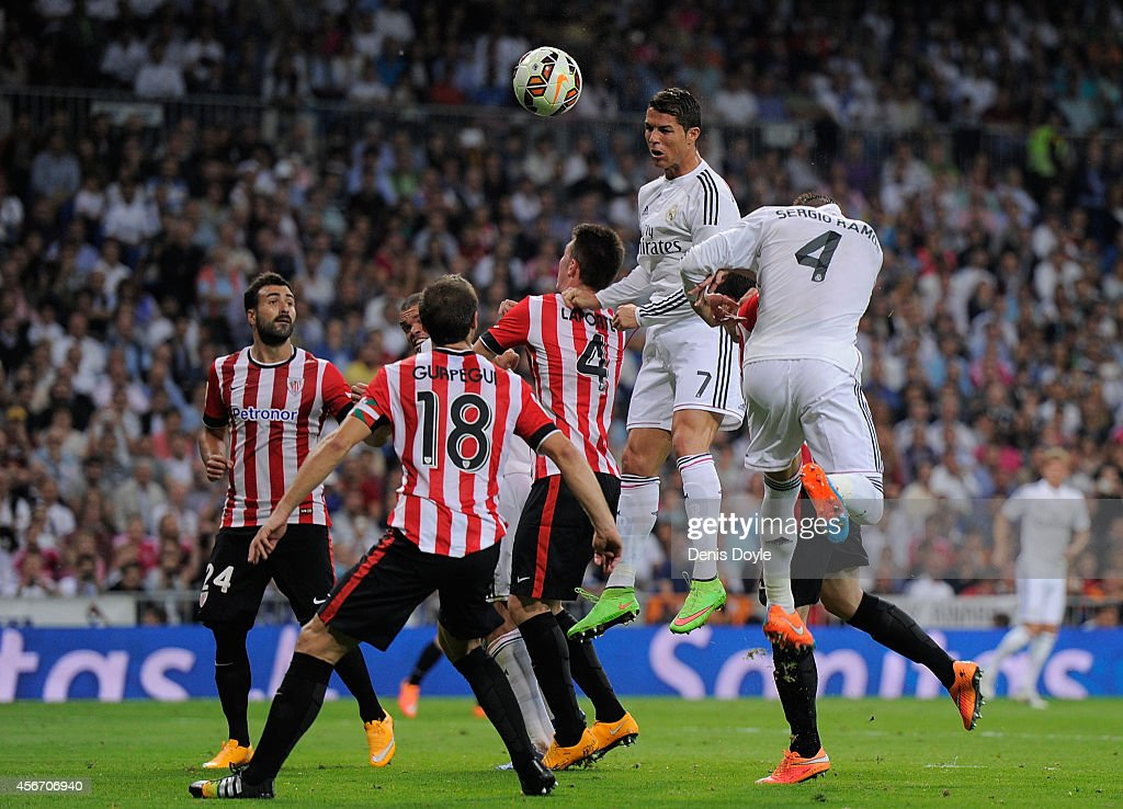Cristiano Ronaldo of Real Madrid heads the ball beside Aymeric Laporte of Club Athletic during the La Liga match between Real Madrid CF and Athletic Club at Estadio Santiago Bernabeu on October 5, 2014 in Madrid, Spain.