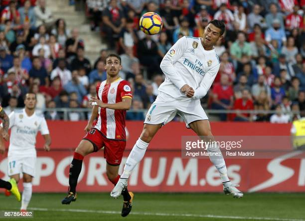 Cristiano Ronaldo of Real Madrid heads the ball during the La Liga match between Girona and Real Madrid at Estadi de Montilivi on October 29 2017 in...