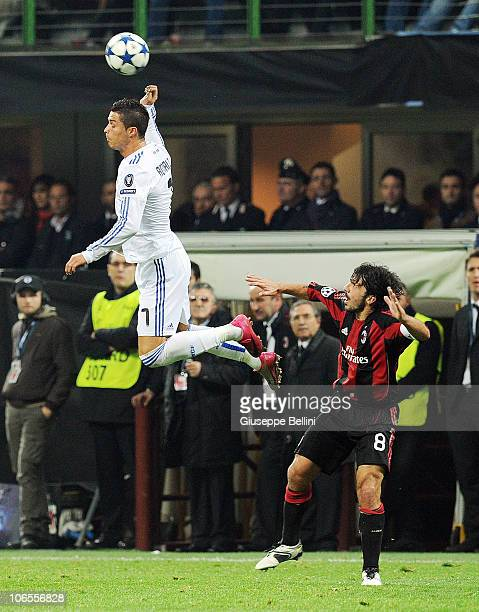 Cristiano Ronaldo of Real Madrid heads the ball during the Uefa Champions League group G match between Milan and Real Madrid at Stadio Giuseppe...