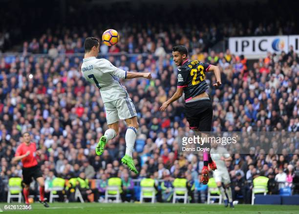 Cristiano Ronaldo of Real Madrid heads the ball past Diego Antonio Reyes of RCD Espanyol during the La Liga match between Real Madrid CF and RCD...