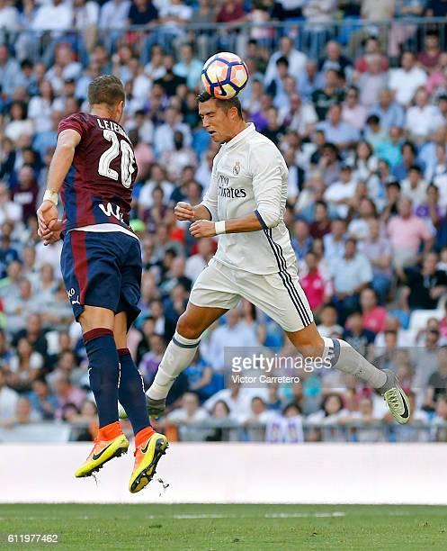 Cristiano Ronaldo of Real Madrid heads the ball past Florian Lejeune of Eibar during the La Liga match between Real Madrid CF and SD Eibar at Estadio...