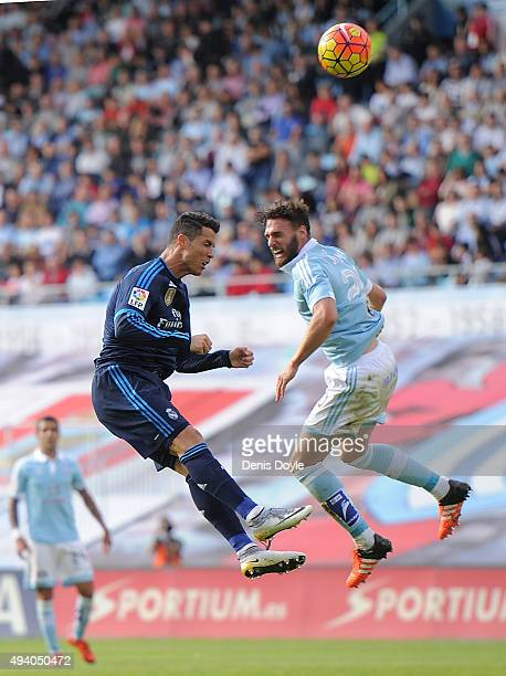 Cristiano Ronaldo of Real Madrid heads the ball past Sergi Gomez of Celta Vigo during the La Liga match between Celta Vigo and Real Madrid at Estadio...
