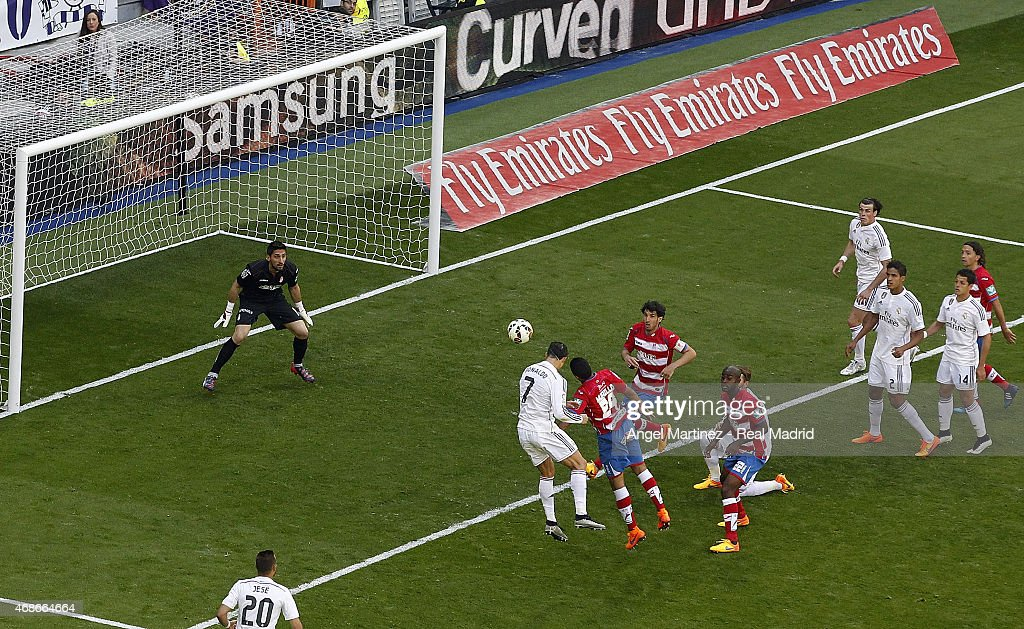 Cristiano Ronaldo of Real Madrid heads the ball to score his team's ninth goal during the La Liga match between Real Madrid CF and Granada CF at Estadio Santiago Bernabeu on April 5, 2015 in Madrid, Spain.