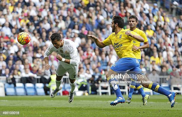 Cristiano Ronaldo of Real Madrid heads the ball to score his team's second goal during the La Liga match between Real Madrid CF and UD Las Palmas at...