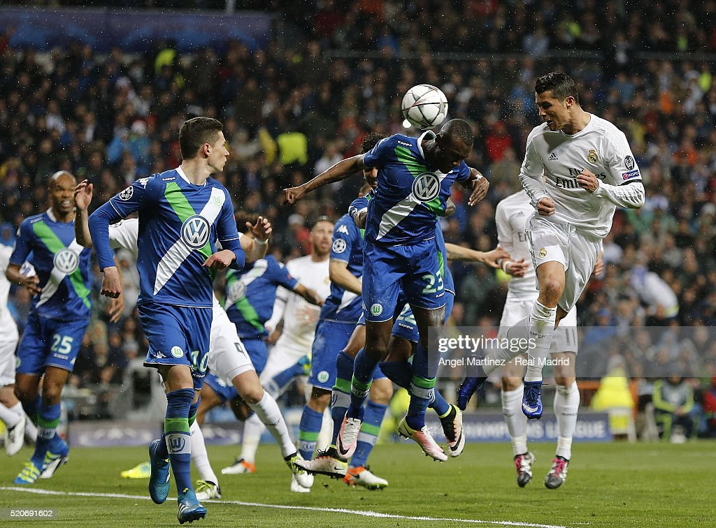 Cristiano Ronaldo of Real Madrid heads the ball to score his team's second goal during the UEFA Champions League quarter final second leg match between Real Madrid and VfL Wolfsburg at Estadio Santiago Bernabeu on April 12, 2016 in Madrid, Spain.