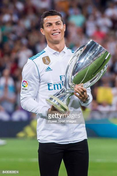 Cristiano Ronaldo of Real Madrid holds one of their trophies prior to the La Liga 201718 match between Real Madrid and Valencia CF at the Estadio...
