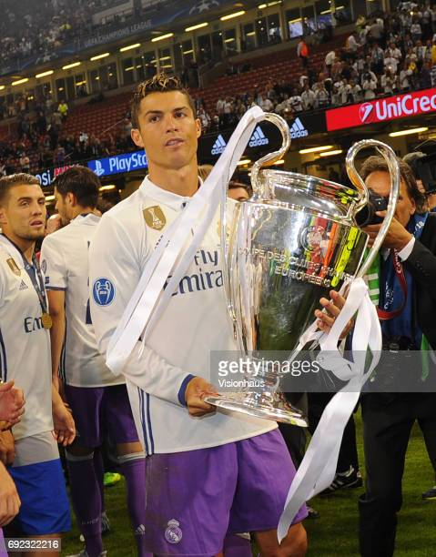 Cristiano Ronaldo of Real Madrid holds the Champions League trophy during the UEFA Champions League Final between Juventus and Real Madrid at...