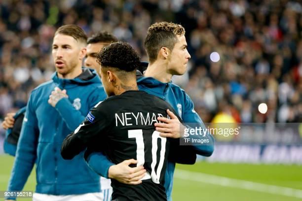 Cristiano Ronaldo of Real Madrid hugs Neymar of Paris SaintGermain during the UEFA Champions League Round of 16 First Leg match between Real Madrid...