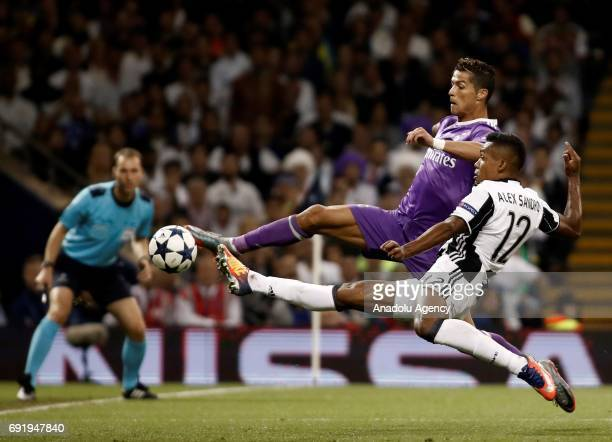 Cristiano Ronaldo of Real Madrid in action against Alex Sandro of Juventus during UEFA Champions League Final soccer match between Juventus and Real...