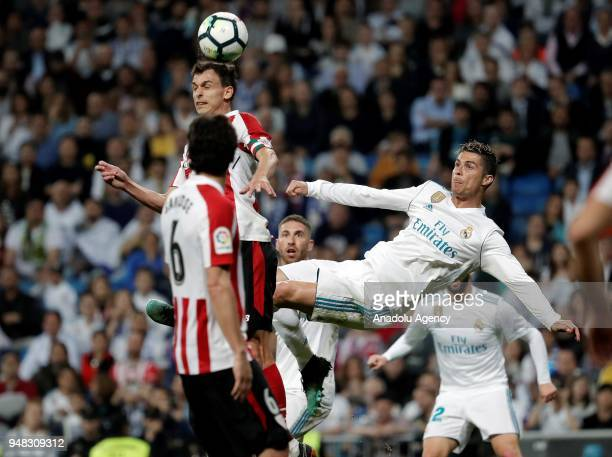 Cristiano Ronaldo of Real Madrid in action against Ander Iturraspe of Athletic Bilbao during the La Liga soccer match between Real Madrid and...