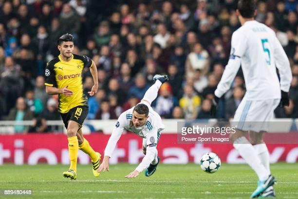 Cristiano Ronaldo of Real Madrid in action against Borussia Dortmund Mahmoud Dahoud during the Europe Champions League 201718 match between Real...