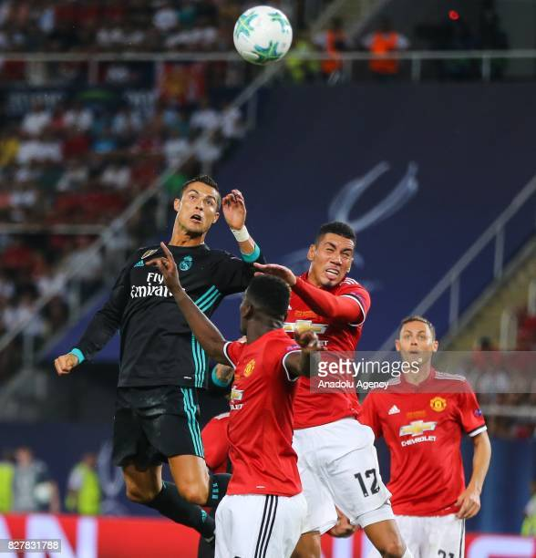 Cristiano Ronaldo of Real Madrid in action against Chris Smalling of Manchester United during the UEFA Super Cup final between Real Madrid and...