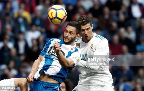 Cristiano Ronaldo of Real Madrid in action against Florin Andone of Deportivo La Coruna during the La Liga match between Real Madrid and Deportivo La...