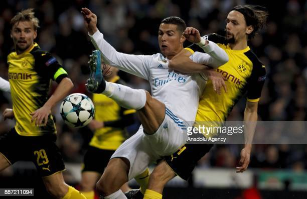 Cristiano Ronaldo of Real Madrid in action against Neven Subotic of Borussia Dortmund during the UEFA Champions League group H match between Real...