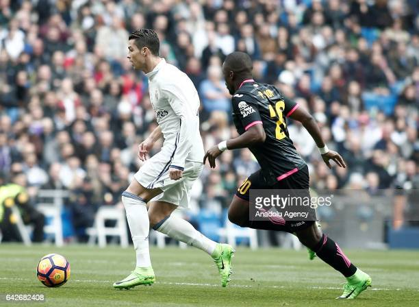 Cristiano Ronaldo of Real Madrid in action against Papakouli Diop of Espanyol during the La Liga football match between Real Madrid and Espanyol at...