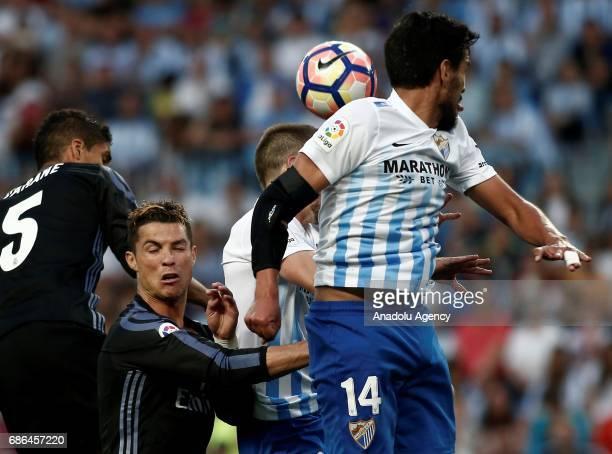 Cristiano Ronaldo of Real Madrid in action against Recio del Pozo of Malaga during the La Liga match between Malaga and Real Madrid at La Rosaleda...