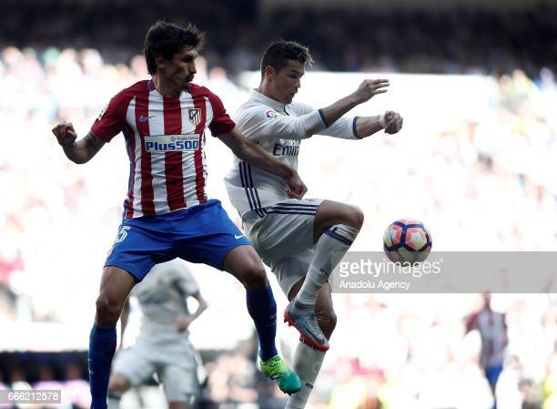 Cristiano Ronaldo of Real Madrid in action against Stefan Savic of Atletico Madrid during the La Liga football match between Real Madrid and Atletico...