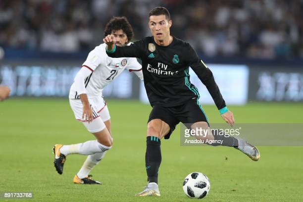 Cristiano Ronaldo of Real Madrid in action against Yaqoub Al Hosani of Al Jazira during 2017 FIFA Club World Cup semi final match between Al Jazira...