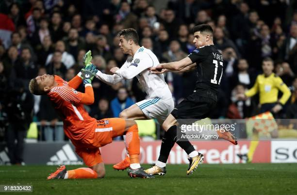 Cristiano Ronaldo of Real Madrid in action against Yuri Berchiche and Alphonse Areola of Paris SaintGermain during the UEFA Champions League Round of...