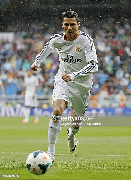 Cristiano Ronaldo of Real Madrid in action during the La Liga match between Real Madrid and CA Osasuna at Estadio Santiago Bernabeu on April 26 2014...