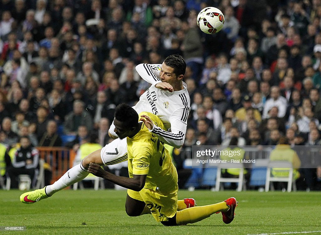 Cristiano Ronaldo of Real Madrid is brought down in the area by Eric Bailly of Villarreal to win a penalty during the La Liga match between Real Madrid CF and Villarreal CF at Estadio Santiago Bernabeu on March 1, 2015 in Madrid, Spain.