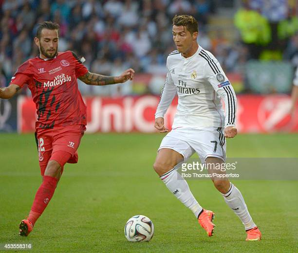 Cristiano Ronaldo of Real Madrid is challenged by Aleix Vidal Parreu of Sevilla FC during the UEFA Super Cup match between Real Madrid and Sevilla FC...