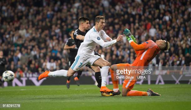 Cristiano Ronaldo of Real Madrid is challenged by Alphonse Areola of Paris SaintGermain during the UEFA Champions League Round of 16 First Leg match...