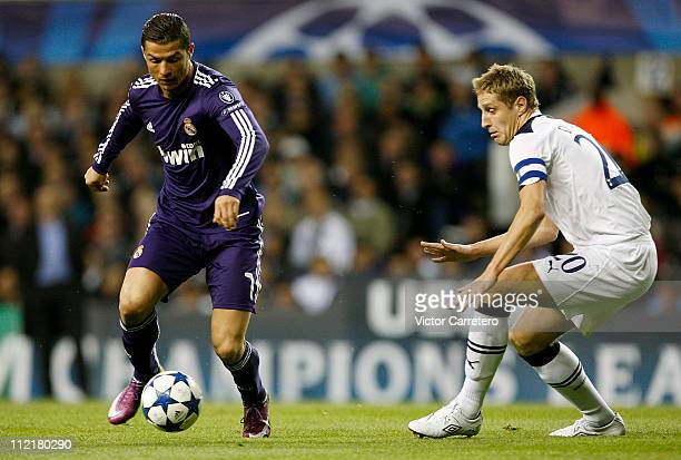 Cristiano Ronaldo of Real Madrid is challenged by Michael Dawson of Spurs during the UEFA Champions League quarter final second leg match between...
