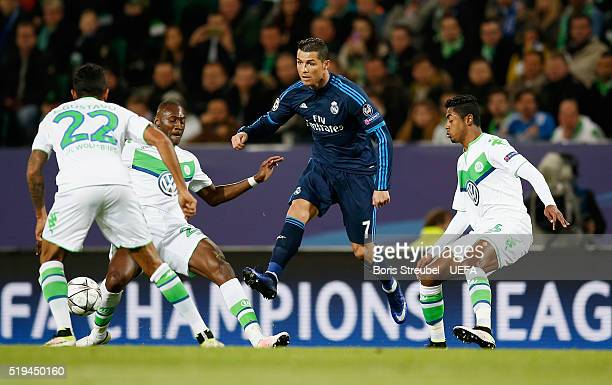 Cristiano Ronaldo of Real Madrid is challenged by players of Wolfsburg during the UEFA Champions League quartel final first leg match between VfL...