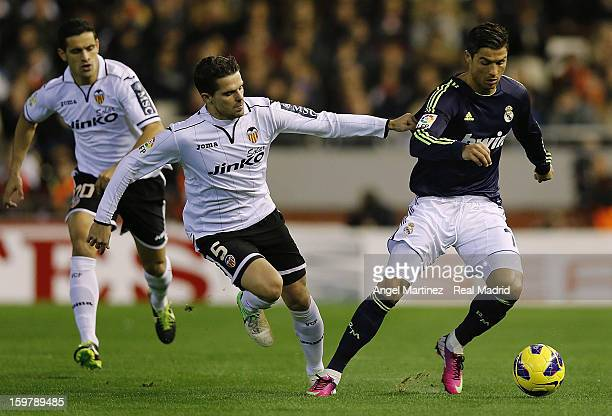 Cristiano Ronaldo of Real Madrid is chased by Fernando Gago of Valencia during the La Liga match between Valencia CF and Real Madrid at Estadio...