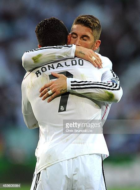 Cristiano Ronaldo of Real Madrid is congratulated by his teammate Sergio Ramos after scoring the opening goal during the UEFA Super Cup match between...