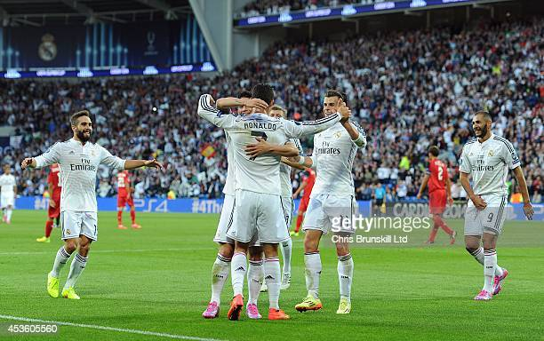 Cristiano Ronaldo of Real Madrid is congratulated by his teammates after scoring the opening goal during the UEFA Super Cup match between Real Madrid...