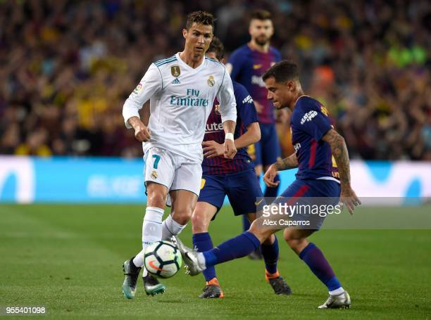 Cristiano Ronaldo of Real Madrid is faced by Philippe Coutinho of Barcelona during the La Liga match between Barcelona and Real Madrid at Camp Nou on...